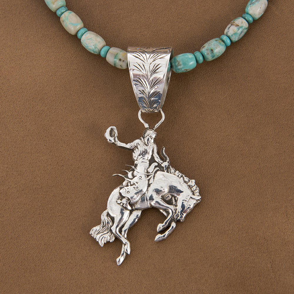 DOUBLE SIDED BRONC PENDANT